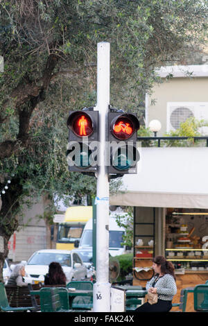 Red Pedestrian and bicycle traffic light. As bicycle riding is becoming more popular special bicycle lanes are being - Stock Photo