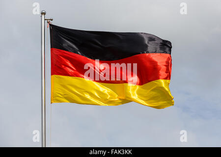 German Flag waving in the wind - Stock Photo