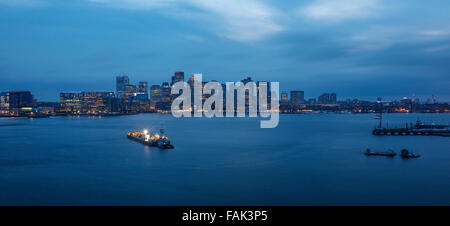 Harbor with skyline at dusk, Boston, Massachusetts, USA - Stock Photo