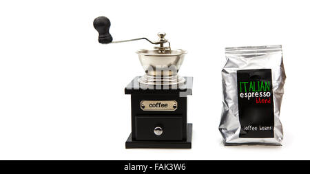 Vintage coffee grinder with coffee beans with white copy space - Stock Photo