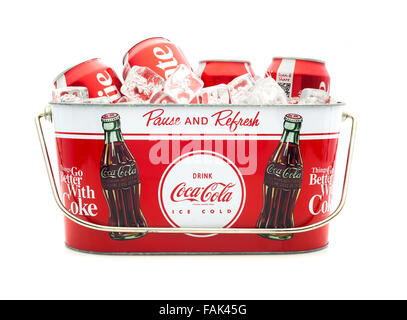 Cold Coca-Cola Cans in a Coca-Cola Ice bucket on a white background - Stock Photo