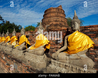 Buddha statues in front of the Central Stupa, Wat Yai Chai Mongkhon, Thailand, Asia - Stock Photo