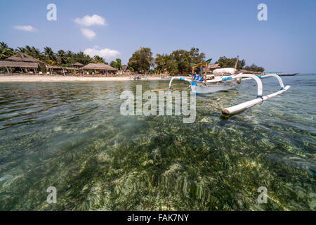 outrigger canoe at the beach on the small island Gili Air, Lombok, Indonesia, Asia - Stock Photo
