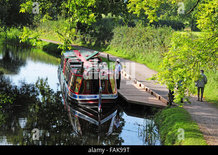 Barge Tivertonian moored on the Grand Western Canal Devon. - Stock Photo