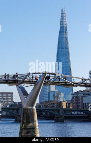 People enjoying sunny day on the Millennium Bridge, London England United Kingdom UK - Stock Photo