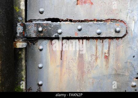 Rusty steel hinch on steel bunker tunnel door, Artillery Hill, Fort Worden State Park, Port Townsend, Washington, - Stock Photo
