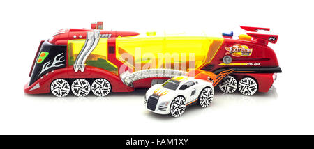 Extreme Model Racing Car And Transporter on a White Background - Stock Photo