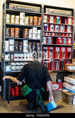 Gainesville Florida SE 1st Street Starbucks Coffee cafe inside man employee barista - Stock Photo