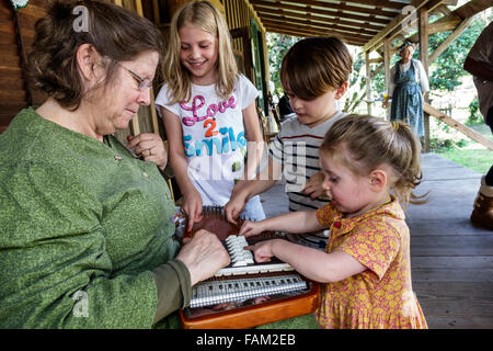 Gainesville Florida Dudley Farm State Park Homestead and Living History Museum property volunteer reenactor woman - Stock Photo