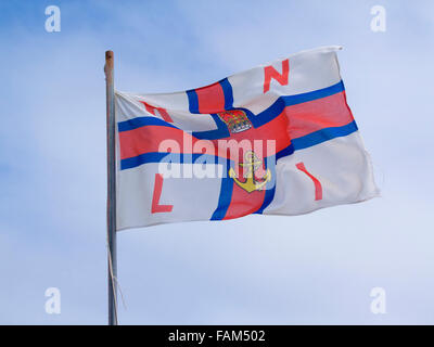 Royal National Lifeboat Institute ( RNLI ) Flag Fluttering in the Breeze, UK - Stock Photo