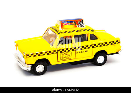New York taxi yellow cab dinky toy Cutout cut out white background isolated copy space - Stock Photo