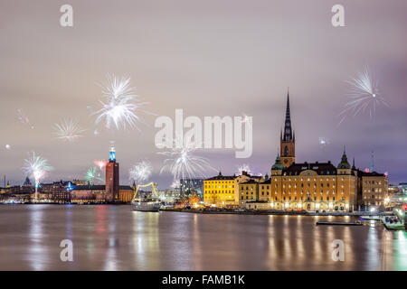 Stockholm, Sweden – Jan 1, 2016: New Year Fireworks are popping across Stockholm islands and city hall on Jan 1 - Stock Photo
