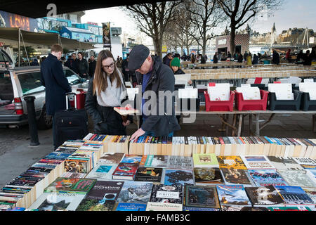 People browsing in the Southbank Book Market in London. - Stock Photo