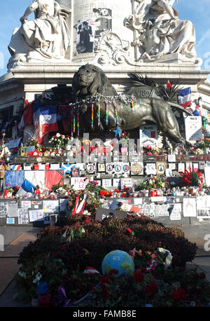 People left memorial items around the statue of Palace de la Republique - Stock Photo