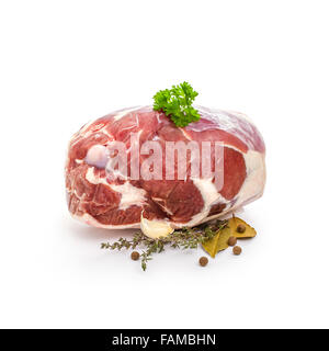 Raw lamb leg with bone, spices, isolated on white - Stock Photo