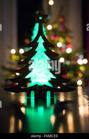 metal christmas tree with real tree in back - Stock Photo