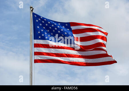 Stars and Stripes, American flag blowing in wind - Stock Photo