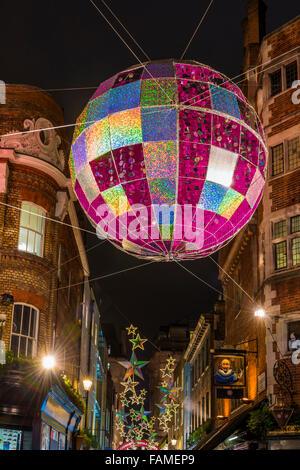 Christmas lights on Carnaby Street, London UK. - Stock Photo