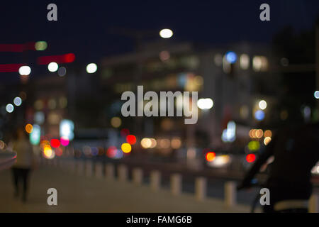 Defocused urban abstract texture ,boke of city lights in the background with blurring lights for your design - Stock Photo