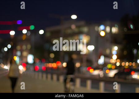 Artistic style - Defocused urban abstract texture ,boke of city lights in the background with blurring lights for - Stock Photo