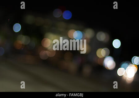 Carlights defocused. Background of blurred street lights in the night - Stock Photo