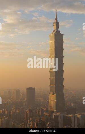 Photograph of Taipei city skyline in Taiwan during sunset. - Stock Photo