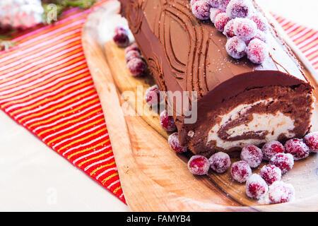 Buche de Noel cake with Christmas decoration. - Stock Photo