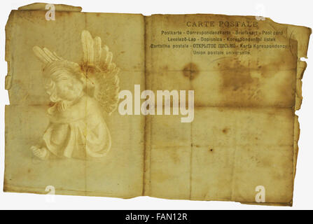 Torn vintage post card with angel. - Stock Photo