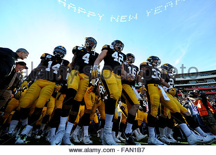 Pasadena, California, USA. 01st Jan, 2016. Iowa enters the field prior to the 102nd Rose Bowl game against Stanford. - Stock Photo