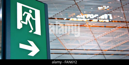 Sign of emergency exit in a Chinese airport, good for conceptual - Stock Photo