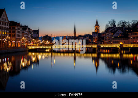 Old town of Zurich at night reflecting on Limmat river, Switzerland. - Stock Photo