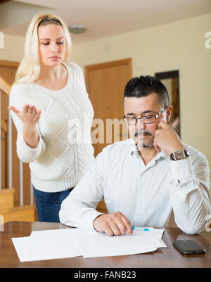 Quarrel in the upset family due to lack of money - Stock Photo