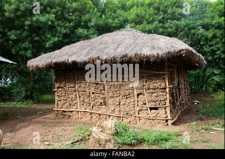 Traditional African Mud Hut With Thatched Roof In Village