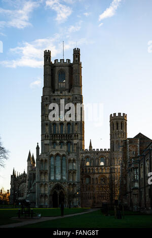 Dawn at the west entrance to Ely cathedral, England, whose construction was started in 1081 during the reign of - Stock Photo