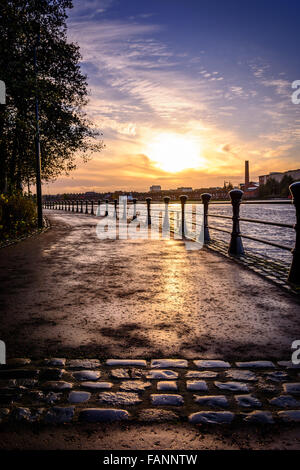 Sunsetting over Belfast from the cobbled paths of the River Lagan towpath - Stock Photo