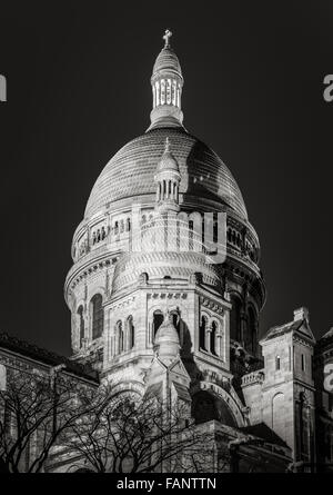 Black & White view of the domes of Sacre Coeur Basilica (Sacred Heart)  illuminated at night in Montmartre, Paris, - Stock Photo