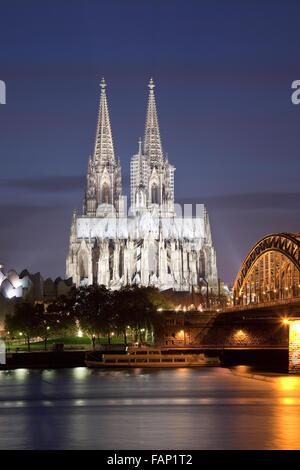 Cologne Cathedral with River Rhine and Hohenzollern Brucke (Bridge), Cologne, Rhine-Westphalia, Germany - Stock Photo