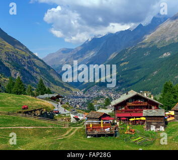 View on chalets and Zermatt village by day - Stock Photo