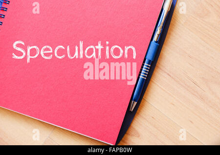 Speculation text concept write on notebook with pen - Stock Photo
