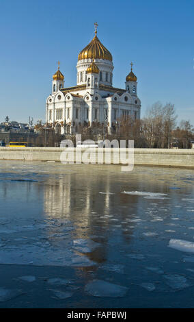 Moscow, Russia - March 03, 2012: cathedral of Jesus Christ Saviour and blocks of ice on Moscow river in spring. - Stock Photo