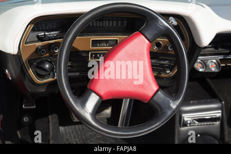 Red steering wheel on an old classy car - Stock Photo