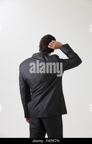 Man scratching his head - Stock Photo