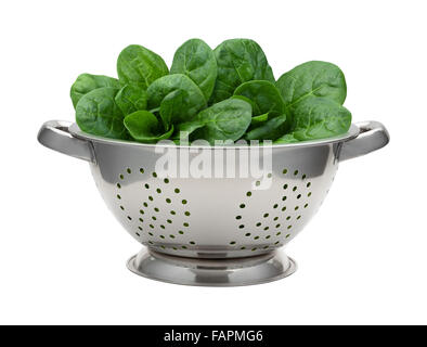 Fresh Spinach in a Stainless Steel Colander. The image is a cut out, isolated on a white background. - Stock Photo