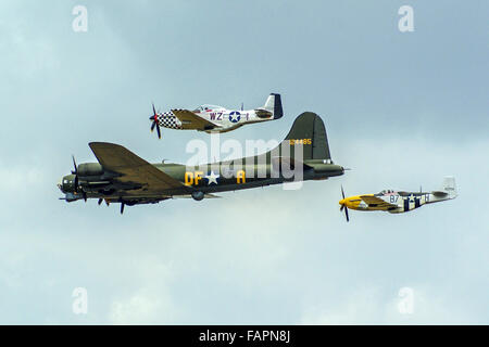 USAF B17 Flying Fortress heavy bomber with P51 Mustang escort of 'Ferocious Frankie' and 'Big Beautiful Doll' - Stock Photo