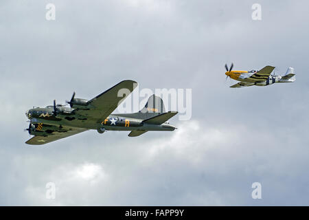 B17 Flying Fortress with P51 Mustang escort - Stock Photo