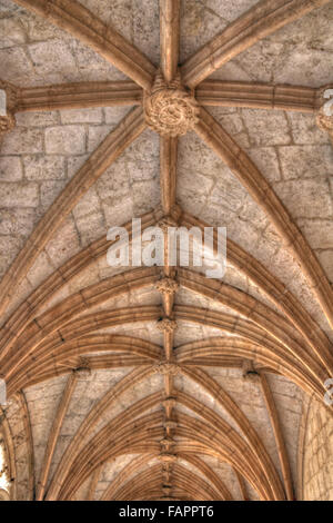 Gothic arches in Jeronimos monastery, Lisbon, Portugal - Stock Photo