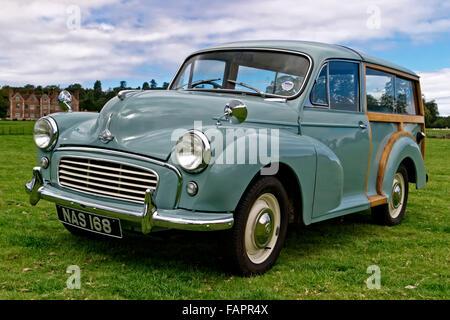 A classic Morris Minor 1000 Traveller motor car at the Breamore House Classic Car Show, near Fordingbridge, Hampshire, - Stock Photo