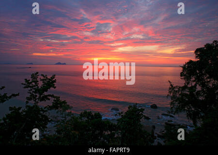 Sunset over the South China Sea, coast at Permai Rainforest, Sarawak, Borneo, Malaysia, Asia - Stock Photo