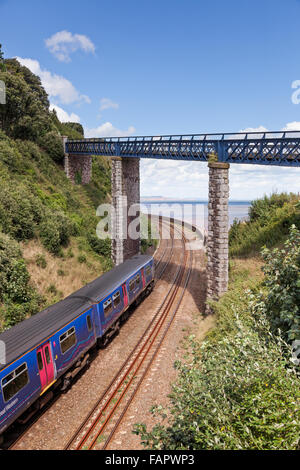 First Great Western train on the Teignmough to Dawlish coastal railway line in Devon - Stock Photo