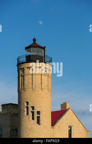 Historic Old Mackinac Point Lighthouse in Michilimackinac State Park in Mackinaw City Michigan - Stock Photo